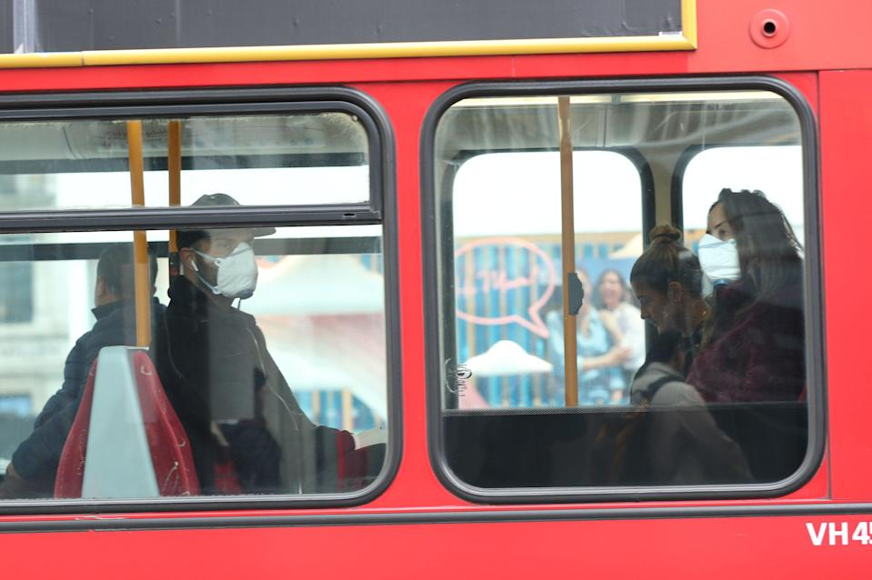 Masks will remain mandatory on public transport in Wales when measures are eased (Yui Mok/PA) (PA Archive)