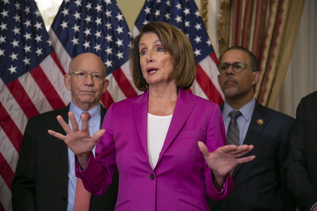 Speaker of the House Nancy Pelosi, D-Calif., flanked by Rep. Peter DeFazio, D-Ore., left, and Rep. Anthony Brown, D-Md., talks to reporters after signing a House-passed a bill requiring that all government workers receive retroactive pay after the partial shutdown ends, at the Capitol in Washington, Friday, Jan. 11, 2019. (AP Photo/J. Scott Applewhite)