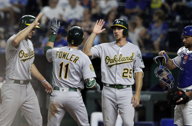 Stephen Piscotty will be getting more laughs than high fives after letting a ball bounce off his head in the outfield (AP Photo)