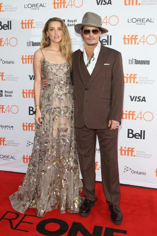 "<p>Diverting eyes away from Johnny Depp isn't easy but his wife, Amber Heard, successfully did just that in an Elie Saab gown at the premiere of ""The Danish Girl.""</p>"