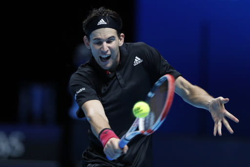 Dominic Thiem of Austria plays a return to Rafael Nadal of Spain during their singles tennis match at the ATP World Finals tennis tournament at the O2 arena in London, Tuesday, Nov. 17, 2020. (AP Photo/Frank Augstein)