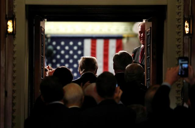 <p>Trump arrives to deliver his first State of the Union address to a joint session of the Congress on Capitol Hill in Washington, D.C., on Jan. 30. (Photos: Joshua Roberts/Reuters) </p>