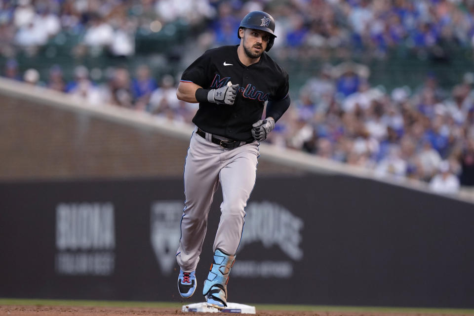 Miami Marlins' Adam Duvall runs the bases after hitting a grand slam during the third inning of the team's baseball game against the Chicago Cubs in Chicago, Friday, June 18, 2021. (AP Photo/Nam Y. Huh)