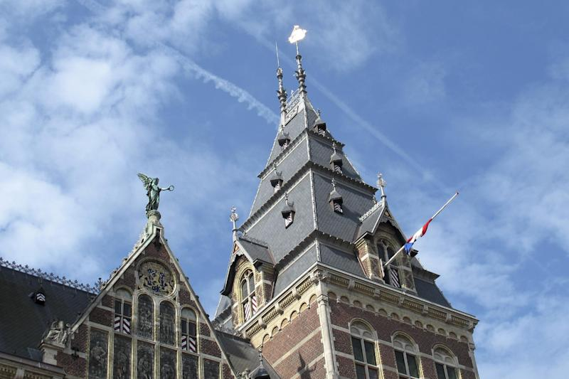 A flag is flying at half-staff at Rijksmuseum in Amsterdam, Friday, Aug. 16, 2013. Members of the Dutch royal family and a small collection of friends are attending a private funeral for Prince Friso, who died this week due to complications from a 2012 skiing accident. He died on Monday, aged 44. Flags are flying at half-staff on official buildings around the country, and thousands of Dutch people have sent messages of condolences via social media. Friso is survived by his wife, Princess Mabel, and two young daughters. (AP Photo/Margriet Faber)