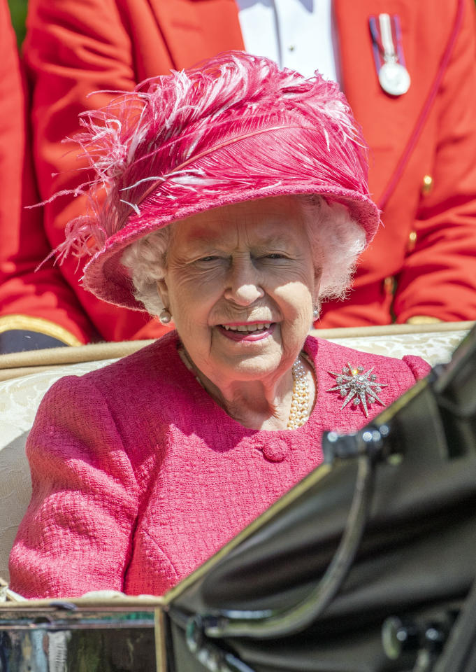 The Queen looks perfect in raspberry pink for day four of the races.<em> [Photo: PA]</em>