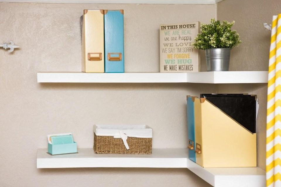 If you find yourself facing cluttered shelves, there's an easy solution, according of Winter: Line up all of your belongings on a single shelf. This way, it makes it far easier to decide what to keep—and what to get rid of. For the items you want to keep but not necessarily display, this trick will also help you better determine what size storage bin you'll need for the excess.