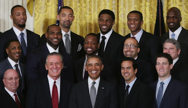 WASHINGTON, DC - JANUARY 14: U.S. President Barack Obama (C) poses for photographs with the National Basketball Association 2012-2013 champion Miami Heat including Rashard Lewis, Mario Chalmers, LeBron James, Juwan Howard, Dwyane Wade, Udonis Haslem, James Jones, Joel Anthony, team President Pat Riley and Head Coach Erik Spoelstra at the White House January 14, 2014 in Washington, DC. This is the second year in a row the team won the championship and made a trip to 1600 Pennsylvania Avenue. (Photo by Chip Somodevilla/Getty Images)