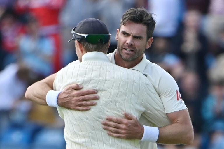 Prize wicket - England's James Anderson (R) celebrates with captain Joe Root after dismissing India skipper Virat Kohli on the first day of the third Test at Headingley on Wednesday
