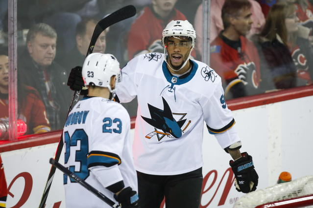 San Jose Sharks' Evander Kane, right, celebrates his goal with teammate Barclay Goodrow during the second period of an NHL hockey game, Tuesday, Feb. 4, 2020 in Calgary, Alberta. (Jeff McIntosh/The Canadian Press via AP)