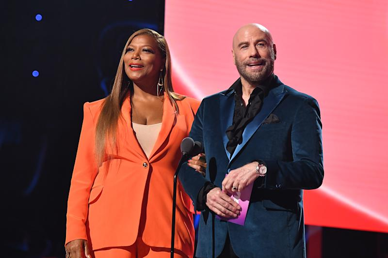 NEWARK, NEW JERSEY - AUGUST 26: Queen Latifah and John Travolta speak onstage during the 2019 MTV Video Music Awards at Prudential Center on August 26, 2019 in Newark, New Jersey. (Photo by Dimitrios Kambouris/VMN19/Getty Images for MTV)