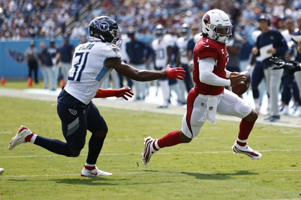 Arizona Cardinals quarterback Kyler Murray (1) scrambles away from Tennessee Titans free safety Kevin Byard (31) in the first half of an NFL football game Sunday, Sept. 12, 2021, in Nashville, Tenn. (AP Photo/Wade Payne)
