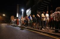 """People arrive for the """"00:01"""" event organised by Egyptian Elbows at Oval Space nightclub, as England lifted most coronavirus disease (COVID-19) restrictions at midnight, in London"""