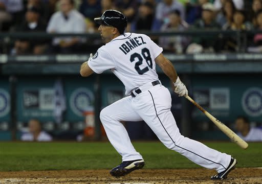 In the fourth inning, Seattle Mariners' Raul Ibanez watches as his second home run of a baseball game takes flight against the Oakland Athletics, Sunday, June 23, 2013, in Seattle. (AP Photo/Ted S. Warren)