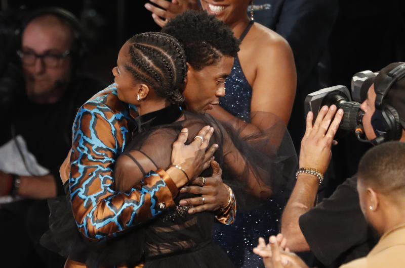 "50th NAACP Image Awards - Show - Los Angeles, California, U.S., March 30, 2019 - Letitia Wright is embraced by Chadwick Boseman after after winning for outstanding breakthrough performance in a motion picture for her role in ""Black Panther."" REUTERS/Mario Anzuoni"