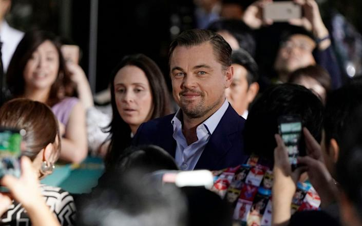 Leonardo DiCaprio signs autographs to fans during the Japan Premiere of the movie 'Once Upon a Time... in Hollywood - REX