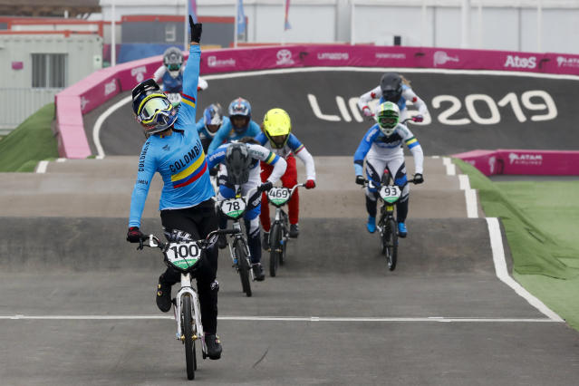Mariana Pajon of Colombia celebrates winning the gold medal in the women's cycling BMX final at the Pan American Games in Lima, Peru, Friday, Aug. 9, 2019. (AP Photo/Fernando Llano)