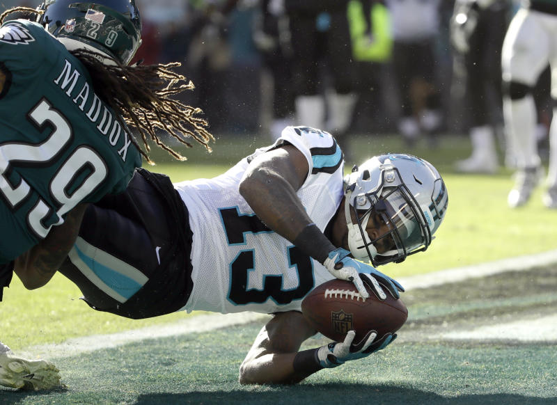 Carolina Panthers wide receiver Jarius Wright (13) dives in for a two-point conversion pass from quarterback Cam Newton, not pictured, as Philadelphia Eagles cornerback Avonte Maddox (29) tries to stop him during the second half of an NFL football game, Sunday, Oct. 21, 2018, in Philadelphia. (AP Photo/Matt Rourke)