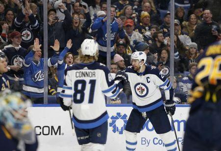 Feb 10, 2019; Buffalo, NY, USA; Winnipeg Jets right wing Blake Wheeler (26) celebrates after scoring a goal during the third period against the Buffalo Sabres at KeyBank Center. Mandatory Credit: Timothy T. Ludwig-USA TODAY Sports