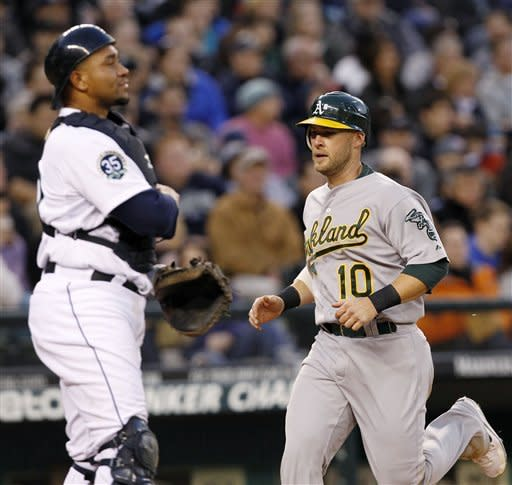 Colon, A's ruin Seattle's home opener with 4-0 win