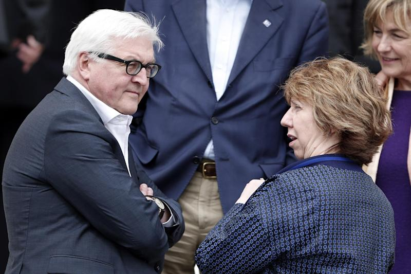 German Foreign Minister Frank-Walter Steinmeier, left, chat with Vice President of the European Commission and High Representative of the Union for Foreign Affairs and security policy Catherine Ashton, as they prepare for a photo during an Informal meeting of Ministers for Foreign Affairs at Zappeion Hall in Athens, on Friday, April 4, 2014. European Union foreign ministers meeting in Athens on Friday urged Russia to take concrete steps to pull troops back from its border with Ukraine but said they wanted to keep communication with Moscow open.(AP Photo/Petros Giannakouris)