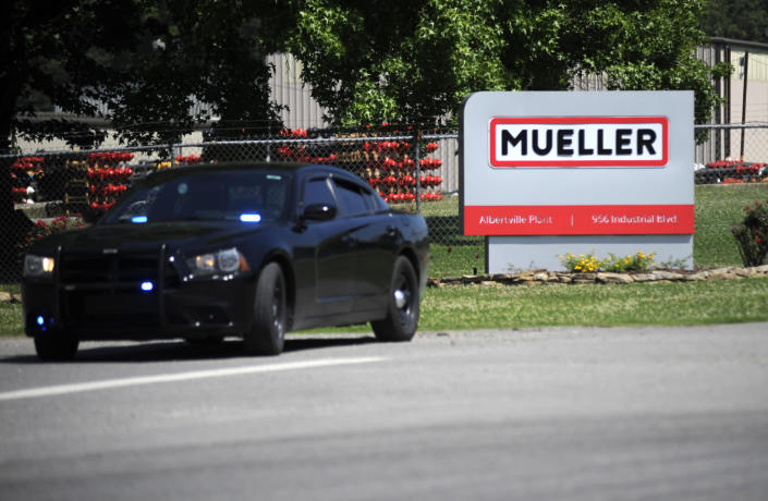 A police car guards the entrance to a Mueller Co. fire hydrant plant where police said multiple people were shot to death and others were wounded in Albertville, Ala., on Tuesday, June 15, 2021. (AP Photo/Jay Reeves)