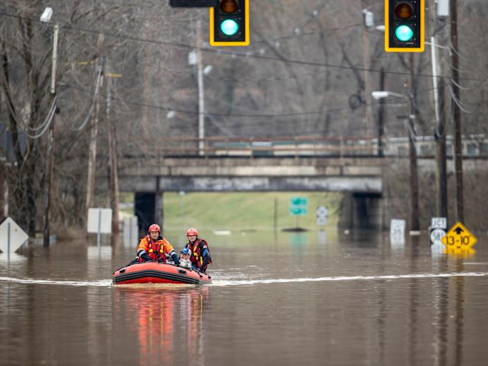 <p>Michael Oiler, left, of the Thelma Fire Department, and Ricky Keeton, of the Oil Springs Fire Department, conduct a water rescue in Paintsville, Ky., following heavy rain on Monday 1 March 2021</p> ((Associated Press))
