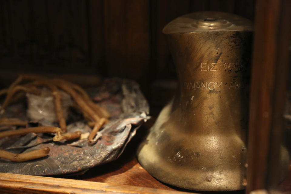 Candles and a small bell recovered from the original St. Nicholas Greek Orthodox Church, destroyed in the Sept. 11, 2001 attacks, are preserved at the Greek Orthodox Archdiocese of America in New York on Wednesday, Aug. 18, 2021. (AP Photo/Jessie Wardarski)