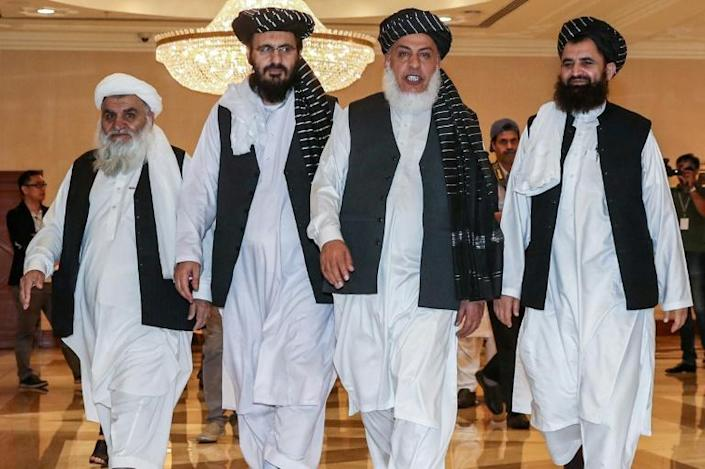 Taliban negotiators arrive at a July 2019 meeting in Qatar with Afghan representatives -- they said they are moving closer to a deal with the US as fresh talks in Doha continue (AFP Photo/KARIM JAAFAR)