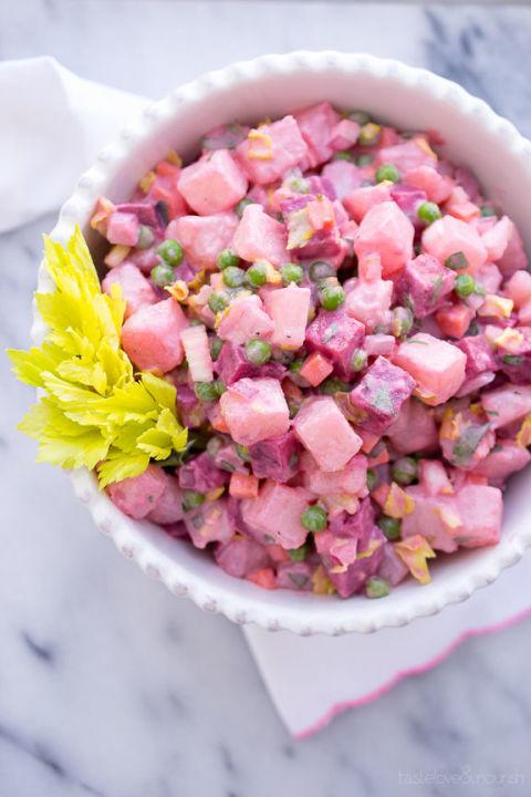 "<p>Easter just isn't Easter without pastels. This colorful, flavorful side dish is packed with <a rel=""nofollow"" href=""http://www.drozthegoodlife.com/healthy-food-nutrition/healthy-recipe-ideas/g805/leafy-greens-recipe-ideas/"">tasty veggies</a> and is sure to wow your dinner guests. Want to make it even healthier? Skip the mayo.</p><p>Grab the recipe from <a rel=""nofollow"" href=""http://www.tasteloveandnourish.com/2014/04/10/beet-potato-salad-salade-russe/"">Taste Love and Nourish</a>.</p>"