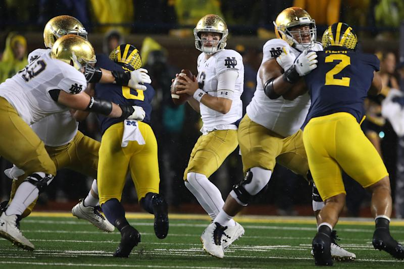 ANN ARBOR, MICHIGAN - OCTOBER 26: Ian Book #12 of the Notre Dame Fighting Irish looks to throw a first half pass against the Michigan Wolverines at Michigan Stadium on October 26, 2019 in Ann Arbor, Michigan. (Photo by Gregory Shamus/Getty Images)