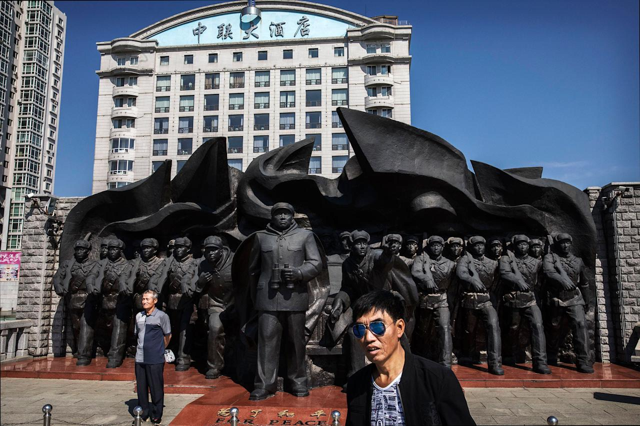 <p>A Chinese man poses in front of a monument commemorating the Korean War on the Yalu river in the border city of Dandong, Liaoning province, northern China across from the city of Sinuiju, North Korea on May 24, 2017 in Dandong, China. (Photo: Kevin Frayer/Getty Images) </p>