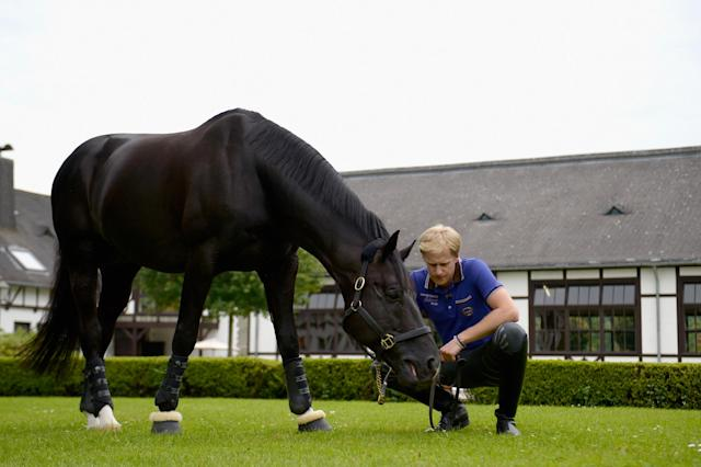 KRONBERG IM TAUNUS, GERMANY - JUNE 19: German dressage rider Matthias Alexander Rath poses with his horse Totilas during a portrait session on June 19, 2012 in Kronberg im Taunus, Germany. (Photo by Dennis Grombkowski/Bongarts/Getty Images)