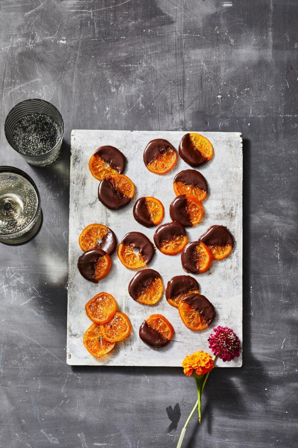 """<p>Dry slices of clementine in a low oven and dip in chocolate for a homemade sweet that beats out super sugary Halloween candy.</p><p><em><a href=""""https://www.goodhousekeeping.com/food-recipes/dessert/a37116518/candied-clementines-recipe/"""" rel=""""nofollow noopener"""" target=""""_blank"""" data-ylk=""""slk:Get the recipe for Candied Clementines »"""" class=""""link rapid-noclick-resp"""">Get the recipe for Candied Clementines »</a></em></p>"""