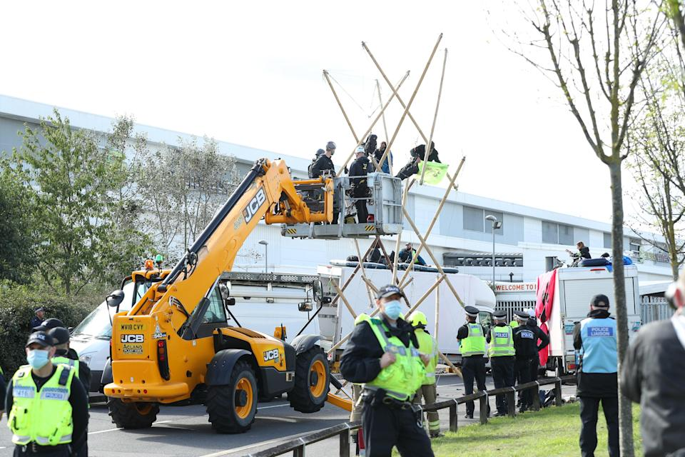 Emergency services used a cherry picker to attempt to remove protesters and dismantle the bamboo lock-ons they used (Yui Mok/PA) (PA Archive)