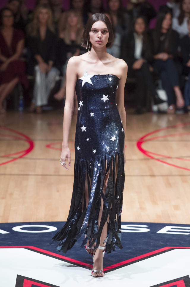 <p><i>Models wears a patriotic, star-sequined dress with fringes from the SS18 Monse collection. (Photo: IMAXtree) </i></p>
