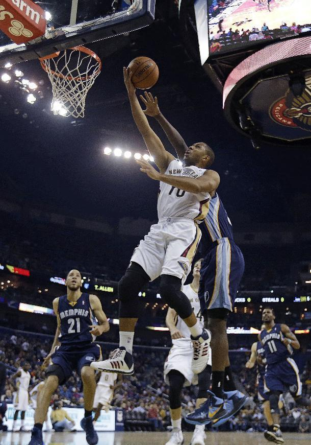 New Orleans Pelicans shooting guard Eric Gordon (10) goes to the basket in front of Memphis Grizzlies forward Zach Randolph in the first half of an NBA basketball game in New Orleans, Friday, Dec. 13, 2013. (AP Photo/Gerald Herbert)