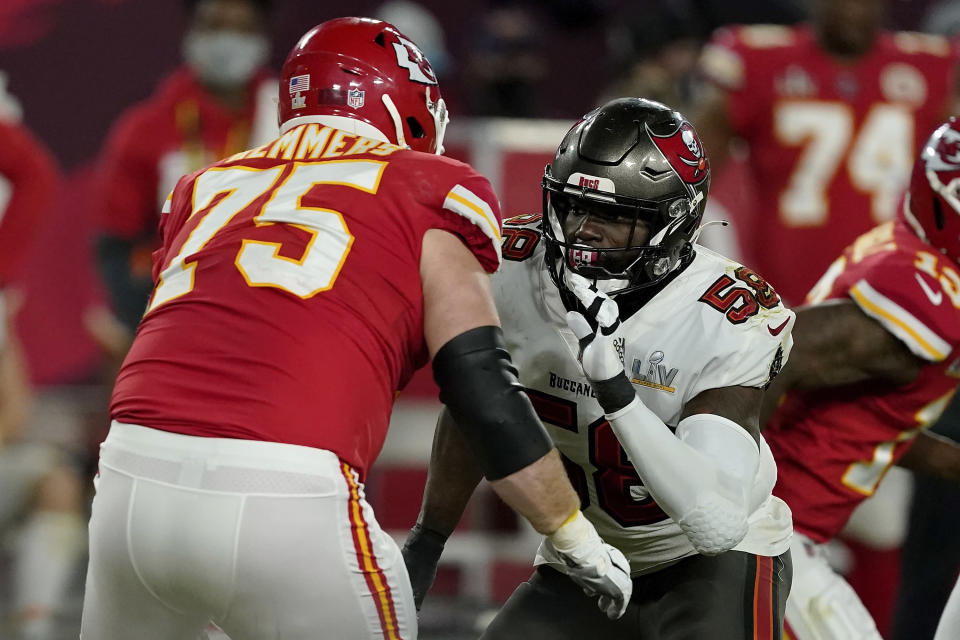FILE - In this Sunday, Feb. 7, 2021 file photo, Tampa Bay Buccaneers outside linebacker Shaquil Barrett (58) moves in to block Kansas City Chiefs offensive tackle Mike Remmers (75) during the second half of the NFL Super Bowl 55 football game in Tampa, Fla. Applying franchise and even transition tags to players can have major ramifications on a team's present and future. That was never more of a consideration than this year, with the salary cap decreasing by, for now, $18 million. That's the first time the cap has gone down, which is due to lost revenues caused by the COVID-19 pandemic.(AP Photo/Steve Luciano, File)