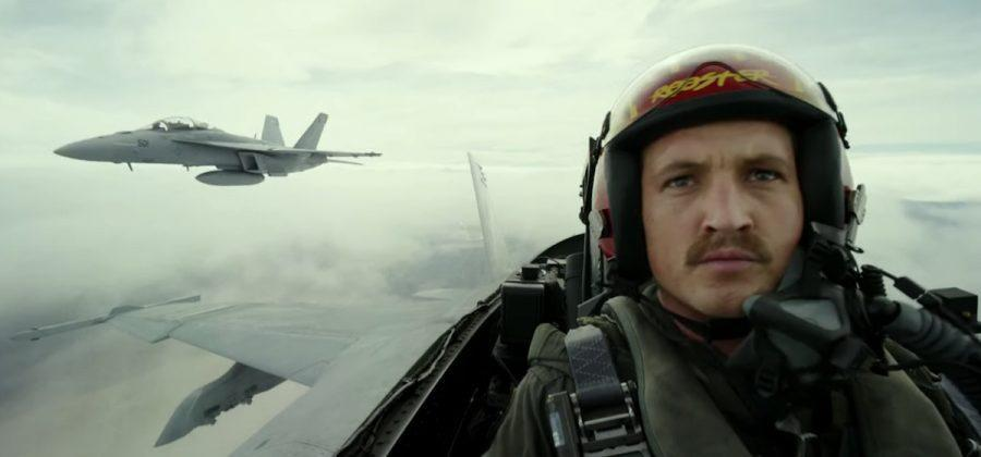 Miles Teller's Rooster flying a fighter jet with anothe rplane behind him