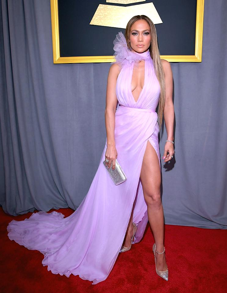 <p>Jennifer Lopez chose a gown that smacked of contrast: Its sweet pastel shade and ruffled tulle collar were offset by a wicked high slit exposing lots of thigh. (Photo: Lester Cohen/WireImage) </p>