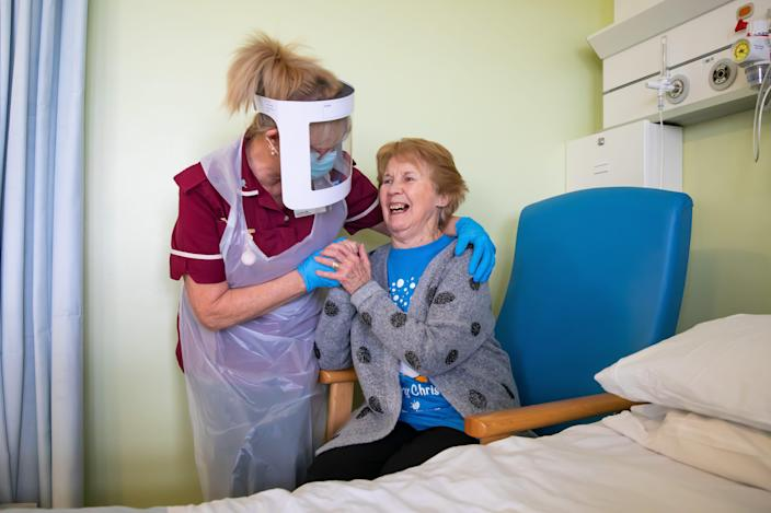 Margaret Keenan, 90, the first patient in the United Kingdom to receive the Pfizer/BioNtech covid-19 vaccine, speaks with Healthcare assistant Lorraine Hill as she prepares to leave University Hospital Coventry & Warwickshire, the day after receiving the first of two doses of the vaccine, on December 9, 2020 in Coventry, United Kingdom. The UK is the first country in the world to start vaccinating people with the Pfizer/BioNTech jab.