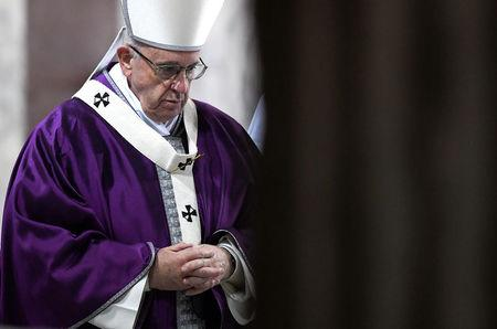 Pope Francis leaves at the end of the Ash Wednesday mass at Santa Sabina Basilica in Rome