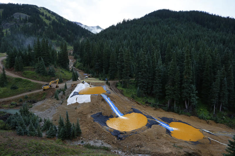 FILE - In this Aug. 12, 2015, file photo, water flows through a series of retention ponds built to contain and filter out heavy metals and chemicals from the Gold King mine accident outside Silverton, Colo. A federal appeals court Friday, July 19, 2019, has sided with the Trump administration after it was sued for dropping an Obama-era proposal that would have required mining companies to prove they have enough money to clean up their pollution. (AP Photo/Brennan Linsley, File)