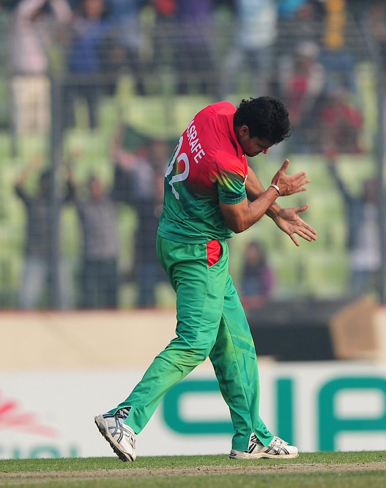 Bangladesh cricketer Mashrafe Bin Murtaza reacts after the dismisslal of unseen West Indies batsman Chris Gayle during the fourth one day international cricket match between Bangladesh and the West Indies  at the Sher-e-Bangla National Cricket Stadium in Dhaka on December 7, 2012. AFP PHOTO/ Munir uz ZAMAN