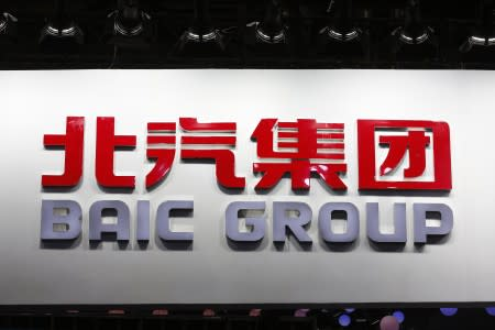 The logo of Beijing Automotive Group (BAIC) is pictured at its booth during the Auto China 2016 auto show in Beijing