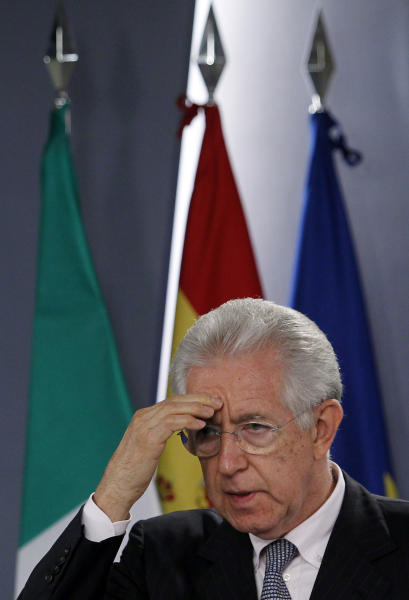 Italy's Prime Minister Mario Monti, gestures during a press conference with Spain's Prime Minister Mariano Rajoy, unseen, at the Moncloa Palace in Madrid, Spain, Thursday, Aug. 2, 2012. (AP Photo/Andres Kudacki)