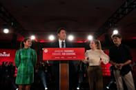 Justin Trudeau delivers his victory speech in Montreal on Sept. 21, 2021, after Liberals win a minority government. He's at the podium with wife Sophie Grégoire Trudeau, left, and their children, Ella-Grace and Xavier. (Ivanoh Demers/CBC/Radio-Canada - image credit)