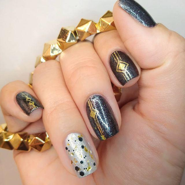 """<p>These 1920's-inspired art deco nails are timeless!</p><p><a href=""""https://www.instagram.com/p/B6wjh32gqyr/&hidecaption=true"""" rel=""""nofollow noopener"""" target=""""_blank"""" data-ylk=""""slk:See the original post on Instagram"""" class=""""link rapid-noclick-resp"""">See the original post on Instagram</a></p>"""