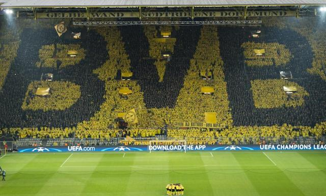 "<span class=""element-image__caption"">Borussia Dortmund fans wore ponchos to create the club's BVB crest – Ballsportverein Borussia - in giant letters. </span> <span class=""element-image__credit"">Photograph: Alexandre Simoes/Getty Images</span>"