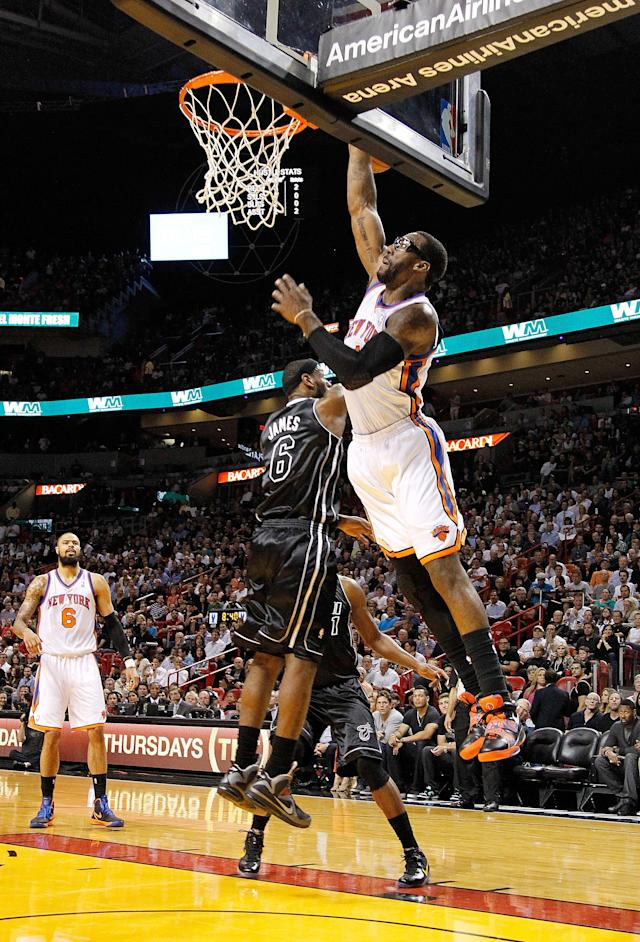 MIAMI, FL - FEBRUARY 23: Amare Stoudemire #1 of the New York Knicks dunks over LeBron James #6 of the Miami Heat during a game at American Airlines Arena on February 23, 2012 in Miami, Florida. NOTE TO USER: User expressly acknowledges and agrees that, by downloading and/or using this Photograph, User is consenting to the terms and conditions of the Getty Images License Agreement. (Photo by Mike Ehrmann/Getty Images)