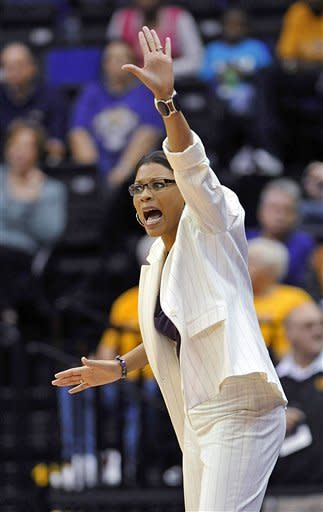 LSU coach Nikki Caldwell shouts instructions to her players during the first half of an NCAA college basketball game against Kentucky in Baton Rouge, La., Sunday, Feb. 24, 2013. (AP Photo/Bill Feig)